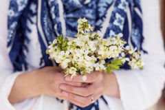 White bouquet of blooming spring flowers in the hands Stock Photo