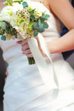 White bouquet. On bride hand Stock Photography