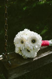 White Bouquet Flower on Brown and Grey Metal Outdoor Swing Royalty Free Stock Photography