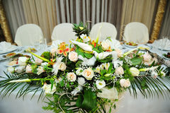 White bouquet of flowers on a festive table bride and groom Royalty Free Stock Photo