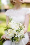 White bouquet in hands of the bride Stock Photo