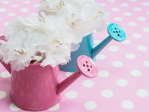 White bouquet in pink and blue flowerpots royalty free stock photo