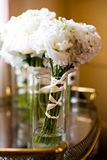White Bouquets. Bouquets of White Flowers in Clear Vases Royalty Free Stock Photos