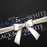 A white bow on a black background Stock Photos