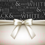 A white bow on a black and white background Stock Images