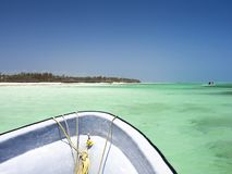 White bow, boat rides through turquoise crystal clear water royalty free stock images