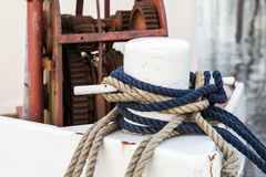 White bow bollard with ropes mounted on old ship Royalty Free Stock Image