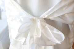 White Bow on Chair. At a wedding a white bow and linens cover a chair for the guests Royalty Free Stock Image