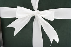 White bow on green gift Stock Photos
