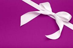 White bow on purple Stock Photo