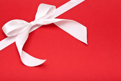 White bow on red Stock Image