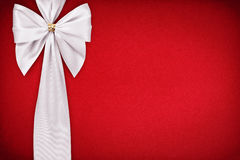White bow on a red background Stock Photo