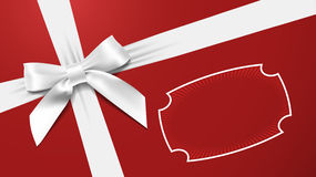 White bow on a red textured background Stock Photography
