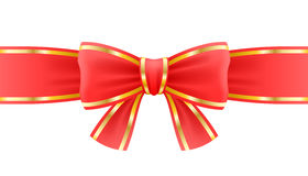 White bow on ribbon with golden edging. Royalty Free Stock Images