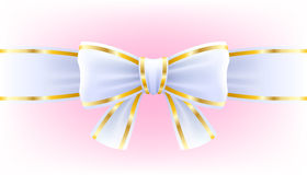 White bow on ribbon with golden edging. Royalty Free Stock Photography