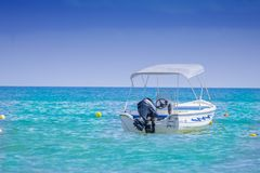White Bow Rider Parked on the Body of Water Stock Image