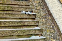 Ribbon on snow covered stairs stock photos