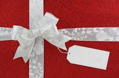 White bow with tag Stock Image