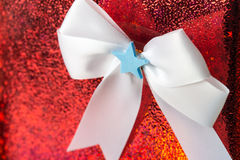 White bow tide on red presents box Royalty Free Stock Image