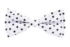 White bow tie in black polka dots isolated. On white background Royalty Free Stock Image