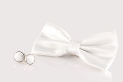 White bow tie with cuff links. On white background Royalty Free Stock Images