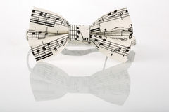 White bow tie with notes on a white background Royalty Free Stock Photography