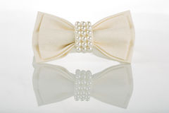 White bow tie with pearls Royalty Free Stock Image