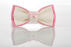 White bow tie with pink accents and a butterfly Stock Image