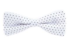 White bow tie with polka dots. Bow tie with polka dots isolated on white background Royalty Free Stock Photo