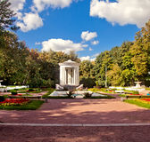 White bower in beautiful park. Beautiful park with antique white bower Royalty Free Stock Photography