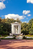 White bower in beautiful park. Beautiful park with antique white bower Stock Photography
