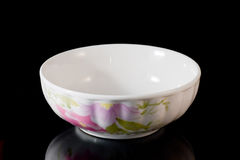 White bowl. China bowl decorated with paintings of flower Royalty Free Stock Images