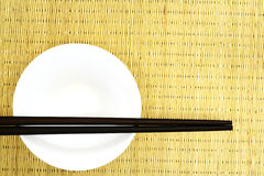 White Bowl. With chopstick on a bamboo background royalty free stock photos
