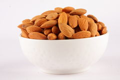White bowl of almond nuts Stock Images