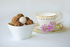 A white bowl with a assortment of truffle chocolates, rum balls Stock Photos
