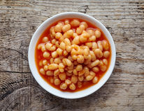 White bowl of beans in tomato sauce from above Stock Photos
