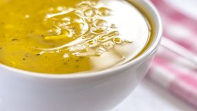 Close of white bowl with cabotia pumpkin soup stock image