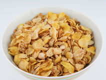 White bowl of cereal. A white bowl full of cereal presented on white background stock images