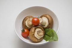 White  bowl of champignons Royalty Free Stock Photos