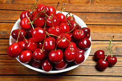 White bowl with cherries fruit Royalty Free Stock Photos