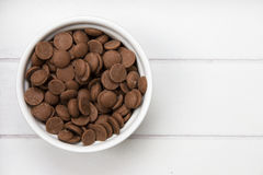 White bowl with chocolate pieces Royalty Free Stock Image