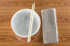 White bowl and chopstick with kitchen towel Royalty Free Stock Photography