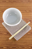 White bowl and chopstick with kitchen towel Stock Image