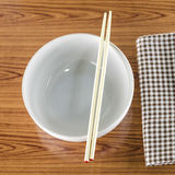 White bowl and chopstick with kitchen towel Stock Photography