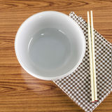 White bowl and chopstick with kitchen towel Stock Photo