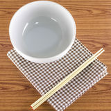 White bowl and chopstick with kitchen towel Stock Images