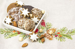 White bowl with christmas cookies. Several sorts of gingerbread cookies royalty free stock photography