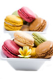 White bowl with colored macaroons. A white bowl with colored macaroons Stock Images