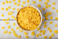 White bowl of corn flakes. On a wooden surface stock photo