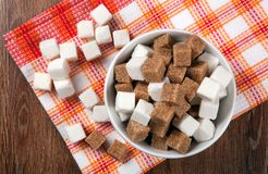 Still life of cubes of white and brown sugar Royalty Free Stock Photography